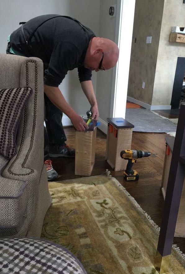 Artisan Craftman installing cabinetry