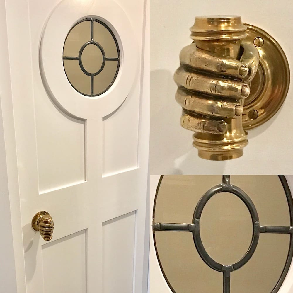 Custom pantry door with brass hand door knob